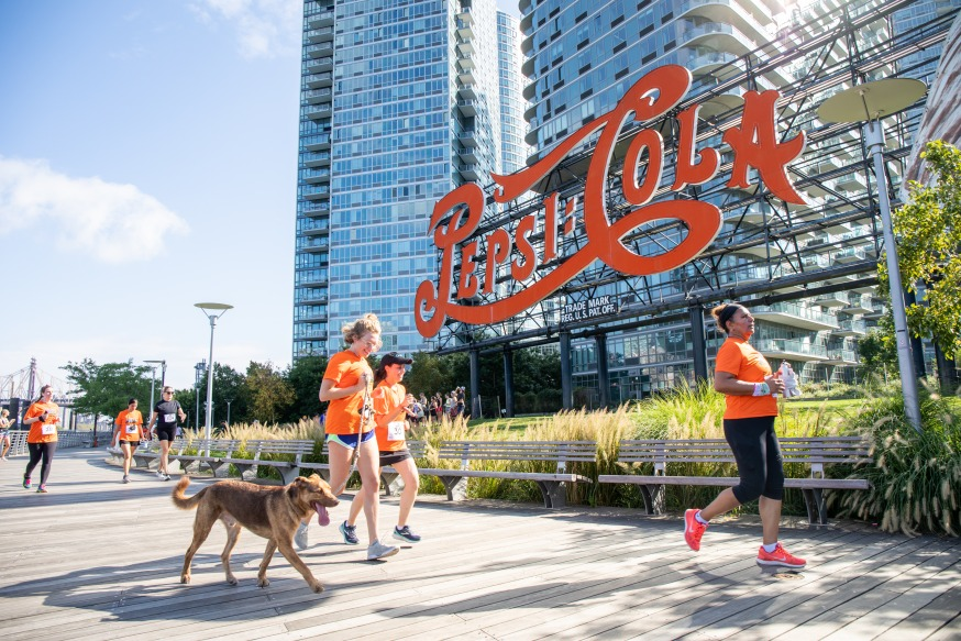 Runners (and a dog) during Saturday's LIC 5k (Photo Alex Lopez)